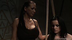 Mistress makes her lesbian slave suck the dildo so it's nice and wet for fucking