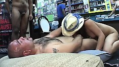 Lexi is the star attraction at an adult store and sucks on a fat fuck