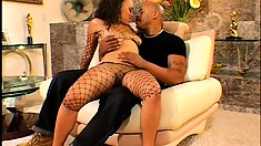 Chocolate chick in fishnet seduces her black honey on the couch