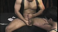 Down in the dungeon, slave boy sucks off master's ringed cock and balls then gets fucked