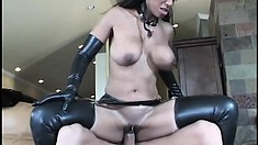 Busty ebony girl in a sexy latex suit has a long white cock deeply invading her ass