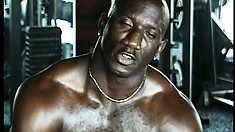 He shows off his big black muscles and gets banged in the ass in a gay three way