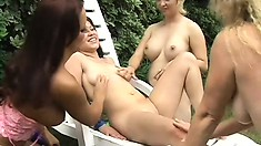 Three lesbian MILFs and one younger cutie munching pussy alfresco