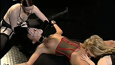 Two dominant ladies with big strap-ons enjoy using their sex slave